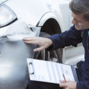 insurance adjuster is inspecting car accident claims