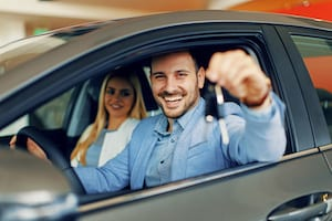 Young couple getting new non-owner car insurance for their new car